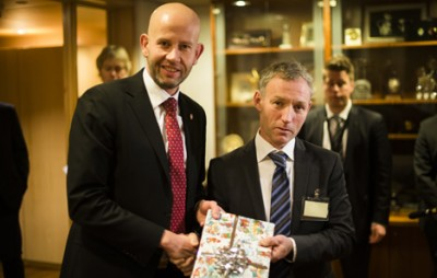 Norwegian Oil Minister Tord LIen (left) was literally handed a Christmas gift of sorts on Friday: New plans from Statoil to develop and operate expansion of the Oseberg field off Bergen. At right, Ivar Aasheim of Statoil. PHOTO: Statoil/Ole Jørgen Bratland