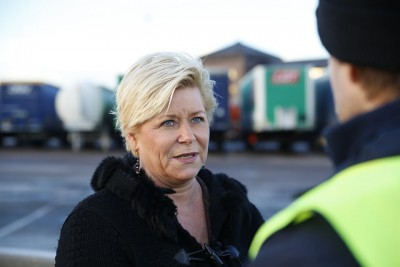 Progress Party boss Siv Jensen, who also serves as Norway's finance minister, with customs agents during a recent border patrol operation in Oslo. Jensen's party is now soaring in public opinion polls. PHOTO: Finansdepartementet