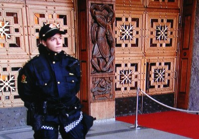 This was just one of the armed police standing guard outside Oslo City Hall's main entrance before Peace Prize winners and the royal family made their entrance. PHOTO: NRK screen grab/newsinenglish.no