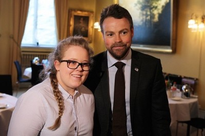 Education Minister Torbjørn Røe Isaksen is making another effort to tackle bullying in Norway. He's shown here with bullying victim Margit Kristina Akselsen, who went public with her story of a tormented childhood at a government-hosted meeting last winter. PHOTO: Kunnskapsdepartementet