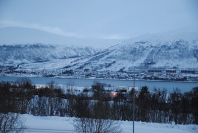 The mountains around Tromsø, as seen here from the University of North Norway, are posing severe avalanche risks this week. PHOTO: newsinenglish.no