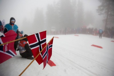 """More than 23,000 people had purchased tickets to the Holmenkollen Ski Festival a week before it began, and many lined the cross-country ski race route despite fog and rainy weather. They cheered on the racers while also commenting that it was """"typical"""" to have bad weather and poor visibility at the annual event. PHOTO: Holmenkollen Skifestival"""