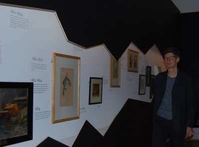 Exhibit designer with his time-line of Hans Gude's life and work, formed to reflect the rugged coastline. PHOTO: newsinenglish.no