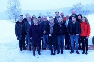 Prime Minister Erna Solberg (front left) gathered with her government ministers in the chilly weather at Hurdal on Monday. The temperature among them was due to rise markedly as they started hashing out next year's state budget. PHOTO: Statsministerens kontor
