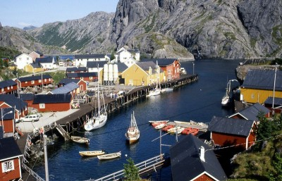 The fishing village of Nusfjord in Lofoten is among those being overrun by tourists in the summer, while Lofoten's fishing industry is skeptical about oil exploration and production in locall waters full of seafood. PHOTO: Wikipedia Commons