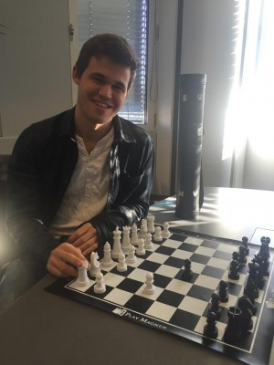 """Magnus Carlsen, shown here at the launch of his official """"Play Magnus"""" chess set at a Norwegian book store last year, has displayed a humorous side before. Now he's been joking and commenting about his challenger for the World Championship title, Sergey Karjakin. PHOTO: Facebook"""
