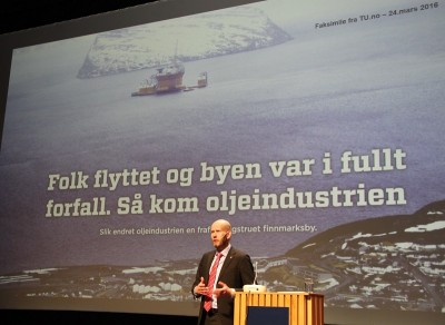 """Oil Minister Tord Lien also opened an oil industry conference in Hammerfest, Barentshavskonferansen, on Tuesday, at which he stressed the importance of the oil industry for Norway as an energy exporter and for economic development in Northern Norway. The text on the screen behind him reads: """"People had moved and the city was in a full state of deterioration. Then came the oil industry."""" PHOTO: EBM/OED"""