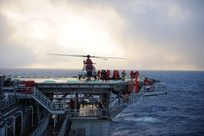 Commuting by helicopter is part of life for offshore oil workers, like disembarking here from a flight to Statoil's Snorre A platform in the North Sea. PHOTO: Statoil/Harald Pettersen