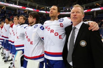Roy Johansen (right) got a great send-off as longtime head coach of the national hockey squad after beating Latvia at the World Championships in Moscow on on Tuesday. PHOTO: Andre Ringuette/HHOF-IIHF Images