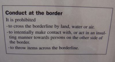 Signs like these are posted all along the border, in several languages. The four people who nonetheless threw rocks over the border claimed they were unaware of the prohibition, which local officials take seriously. PHOTO: newsinenglish.no/Nina Berglund