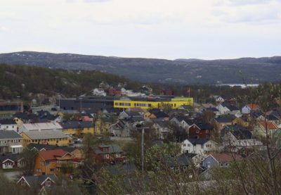 Kirkenes' bright-yellow school complex stands out in its Arctic surroundings. This week the city was shaken when a young student and his mother from Thailand were shot and killed by a Norwegian man who was their stepfather and husband. Police believe he then turned the gun on himself, and was critically injured. He's been charged with the double murder. PHOTO: newsinenglish.no