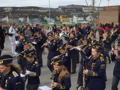 With the old, shut-down buildings of their bankrupt mining company looming in the background, local marching bands were still blowing their horns on the streets of Kirkenes during 17th of May celebrations. PHOTO: newsinenglish.no