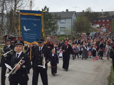 "Even though they're in the midst of tougher times, resident of Sør-Varanger gathered in Kirkenes for their annual 17th of May parade on Tuesday, shouting ""hurrah"" and congratulating one another. PHOTO: newsinenglish.no"