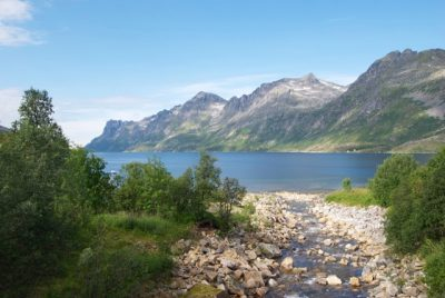 Scenery like this, on the island of Kvaløya just outside Tromsø, has also drawn record numbers of visitors to Northern Norway in recent years. Nearly as many now come in the winter, in the hopes of seeing the Northern Lights. PHOTO: newsinenglish.no