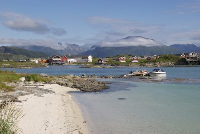 Sommarøya's idyllic surroundings belie the island's busy seafood and tourism industries. In the background, the island of Kvaløya that separates Sommarøya from Norway's northern city of Tromsø. PHOTO: newsinenglish.no