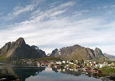 Reine is one of Lofoten's most pictuesque communities, and bursting with tourists during the summer months. Some have caused offense by pitching tents in unsuitable locations, like the church graveyard. PHOTO: Wikipedia Commons