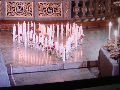 At the Oslo Cathedral, exactly 77 candles, intersersed with roses, were laid down and lit to honour each of the victims of the attacks on July 22, 2011. PHOTO: NRK screen grab/newsinenglish.no