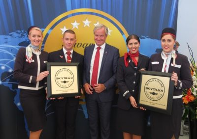 Norwegian Air's CEO Bjørn Kjos (center) posed with flight crews holding the airline's latest Skytrax prizes. PHOTO: Norwegian Air