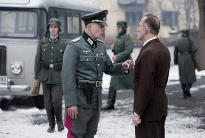 The film also offers a surprisingly sympathetic portrayal of the German ambassador at the time, shown here being lectured by an invading Nazi German officer. PHOTO: Filmweb/Agnete Brun