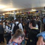 Conflicts collide in passport queues