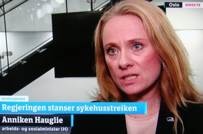 Labour Minister Anniken Hauglie, explaining live on NRK's nightly newscast why she felt compelled to halt a hospital strike that had dragged on since September 7. PHOTO: NRK screen grab/newsinenglish.no