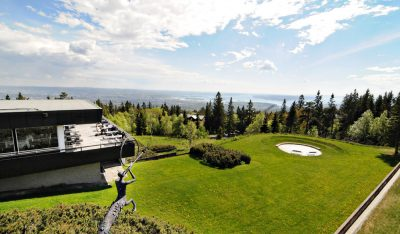 From its perch on a hilltop above Oslo, the Voksenåsen Hotel and Conference Center can offer some inspirational views for trade ministers from around the world. PHOTO: Wikipedia Commons