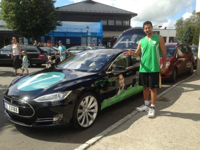 """Member of Parliament Abid Raja proudly posed with his new Tesla Model S in 2013, and """"styled"""" it after his political party, the Liberals (Venstre). PHOTO: Facebook"""