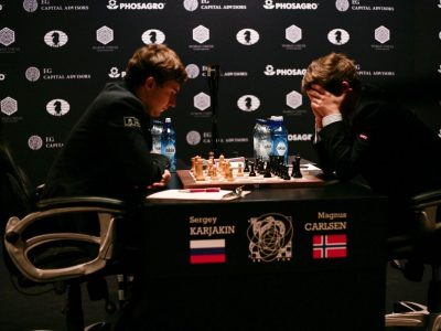 Norwegian chess star Magnus Carlsen buried his face in his hands during the game he ultimately lost to his challenger for the World Championship title, Sergey Karjakin. Carlsen would have more reason to cringe later, as criticism poured in over his bad behaviour after the game. PHOTO: Maria Yassakova/Agon Ltd/ World Chess/ FIDE
