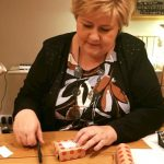 Solberg survives budget crisis
