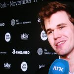 Champion Carlsen thanks his father