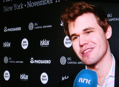 A tired but relieved Magnus Carlsen, being interviewed live on Norwegian Broadcasting (NRK) just minutes after winning his third World Chess Championship in New York on Wednesday, which also was his 26th birthday. PHOTO: NRK screen grab/newsinenglish.no