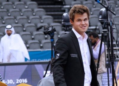 Magnus Carlsen ended rapid chess play smiling and in good humour on Monday, after a rocky start. On Tuesday he also lost a match, but came back with a victory. PHOTO: Doha Chess 2016/Anastasiya Karlovich
