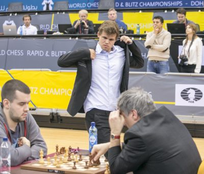 Carlsen watched watching Vassily Ivanchuk (right), who won away Magnus' rapid chess title in Qatar. PHOTO: FIDE Doha Chess 2016/Maria Emelianova