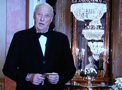 King Harald V, who will turn 80 next month, also stood while speaking from inside the Royal Palace in Oslo. He always speaks first, at 7:30pm on New Year's Eve, followed by the prime minister on New Year's Day. PHOTO: NRK screen grab